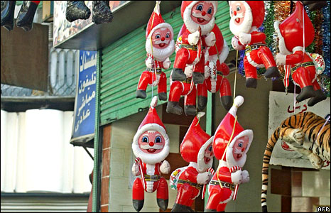 Santas hanging outside a shop in Cairo, Egypt