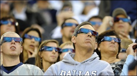 Football fans wearing 3D glasses