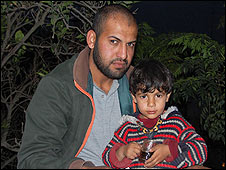 Mohammad Abu Jarad and his young son, Beit Hanoun, Gaza Strip