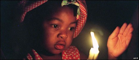 A child in South Africa at a carol service