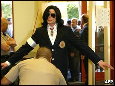 Michael Jackson is searched as he enters the courthouse for his arraignment on child molestation charges, 16 January 2004 in Santa Maria