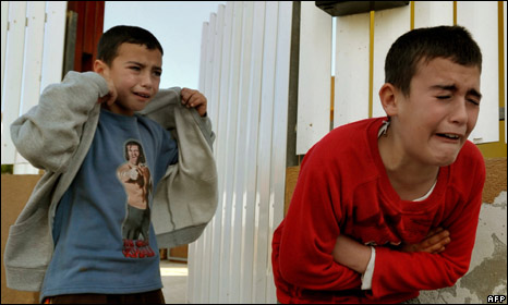Israeli boys shelter during a rocket attack on the Gaza border in December 2008