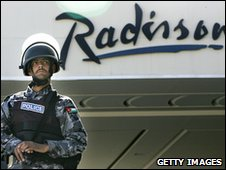 A soldier guards one of the three hotels hit by suicide bombers