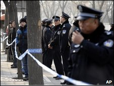 Police officers outside Number One Intermediate People's Court, Beijing, 23/12