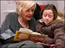 Lady reading to a child