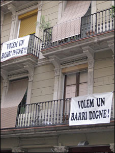 """Banners on balconies """"We want a dignified district!"""""""