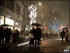 Snow falls on Oxford Street in central London