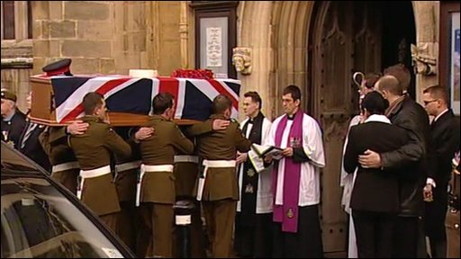 Coffin being carried into church