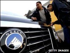 Customers inspect a Geely car, China