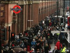 Eurostar passengers queue outside St Pancras station