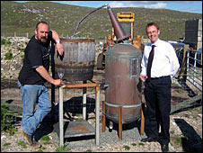 Mr Tayburn, left, and Mr Allan with the illicit still