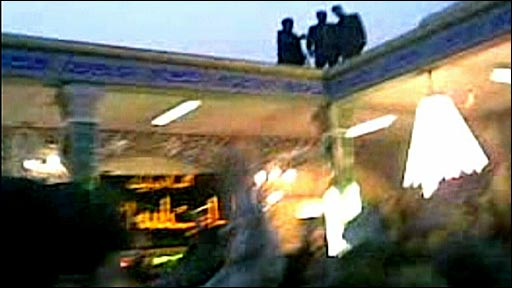 Mobile phone footage of Iranian security agents on roof of building