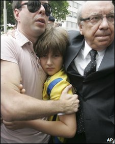 Sean arrives at the US consulate in Rio with his stepfather Joao Paulo Lins e Silva and lawyer Sergio Tostes