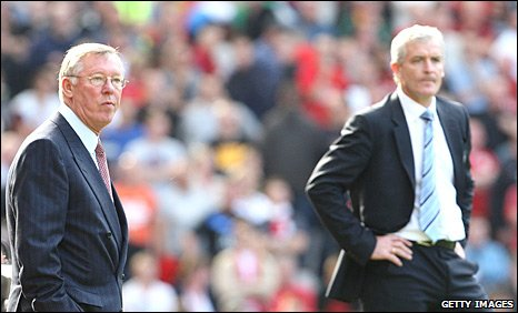 Sir Alex Ferguson and Mark Hughes during the Manchester derby