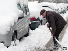man digs out car