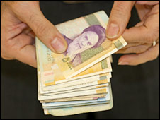 Man holds Iranian banknotes. File photo