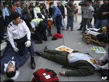 People are treated for injuries in Hong Kong, 25 December