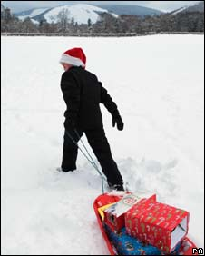 A boy delivers presents in the snow in the Scottish Borders