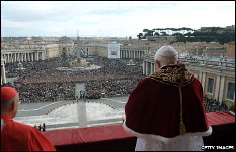 Pope Benedict delivers his blessing from the central balcony of St Peter's, 25 December