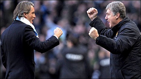 Man City boss Roberto Mancini (left) celebrates assistant manager Brian Kidd