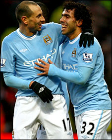 City goalscorers Martin Petrov (left) and carlos Tevez