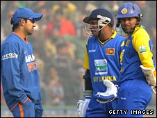India's Gautam Gambhir discusses the pitch with Sri Lankan batsmen Sanath Jayasuriya and Thilan Thushara