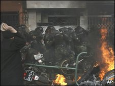 Photo obtained by AP shows Iranian atnti-riot police coming under attack