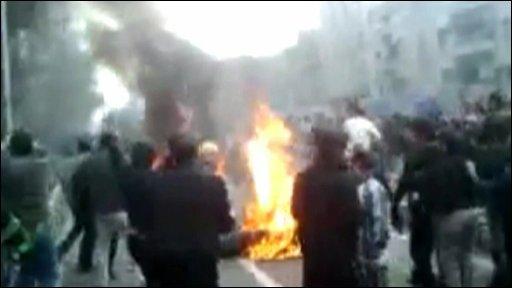 A motorbike on fire in central Tehran