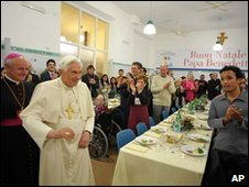 Pope Benedict XVI arrives at a lunch in a soup kitchen in Rome