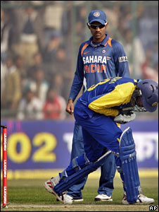 Sri Lankan cricketer Tillakaratne Dilshan after being hit by a ball during the match against India in Kotla