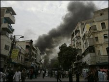 Smoke rises after the bomb in Karachi on 28 December 2009