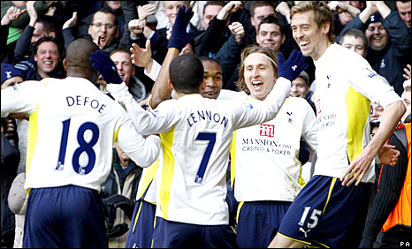 Tottenham celebrate Luka Modric's goal