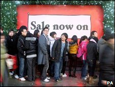 Shoppers outside Selfridges in London