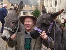 Peter Macleod-Miller with two of his donkeys