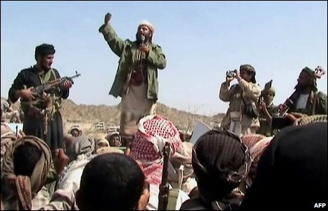 A man claiming to be an al-Qaeda member addresses a crowd gathered in Yemen's southern province of Abyan on December 22, 2009