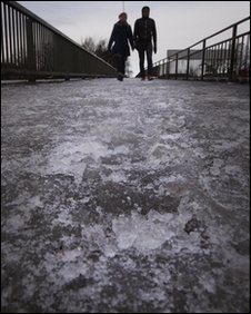 Walkers on an ice covered path in Glasgow