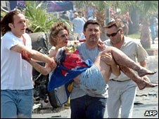 A woman is carried after an explosion on a minibus in Turkey, July 2005