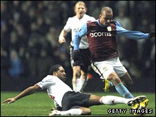 Liverpool's Glen Johnson tackles Gabby Agbonlahor