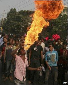 Bangladeshi man performs fire trick