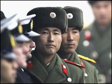 North Korean soldiers with UN honour guard at border with South Korea