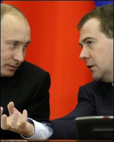 President Medvedev (right) speaking to Vladimir Putin