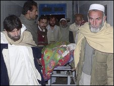 The victim of a bomb attack in north-west Pakistan is moved at a hospital in Bannu, 1 January 2010