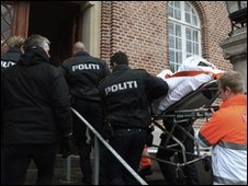 A man who allegedly assaulted Danish cartoonist Kurt Westergaard is carried into court on a stretcher in Aarhus, Denmark