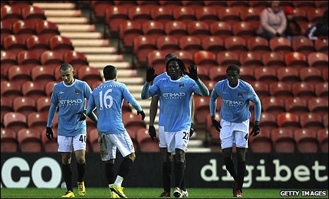 Benjani celebrates after firing in Manchester City's first-half winner