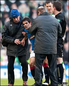 Nacho Novo is helped from the pitch