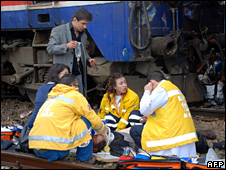 Emergency crew tend to an injured passenger (3 January 2009)