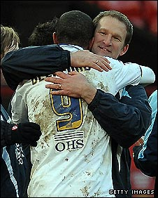 Simon Grayson congratulates goal scorer Jermaine Beckford