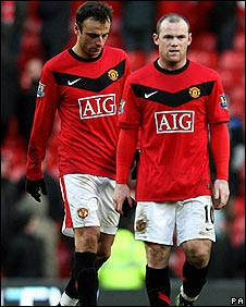 Berbatov and Rooney trudge off after the defeat
