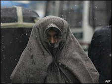 A man shivering in the cold wave in India