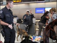 Airport police check bags at a Los Angeles airport on 29 December 2009